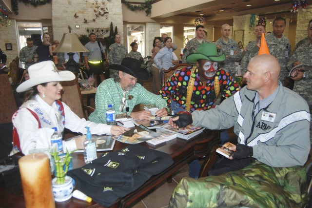 Sgt. 1st Class Todd Griffin (right), Warrior In Transition, meets with San Antonio Stock Show and Rodeo Avery Gonzales, Miss Rodeo Texas 2008; Buck Taylor, actor, who performed in westerns such as Bonanza, Wagon Train, Gunsmoke, and in films such as Tombstone; and Leon Coffee, and Rodeo Clown, who has been a rodeo clown for 29 years.