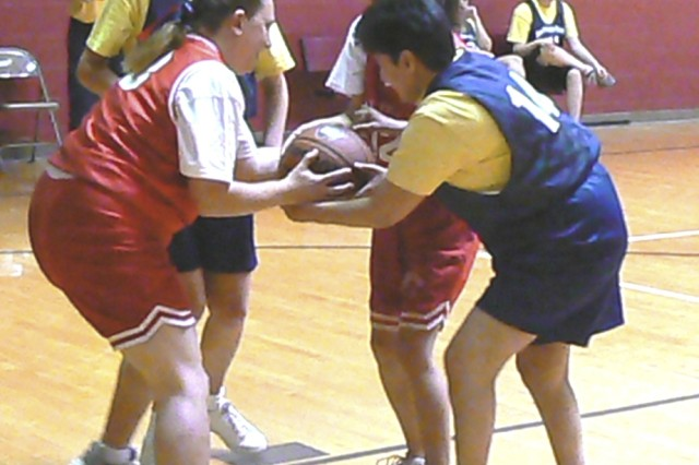 Lucy Mercado forces a jump ball with Christine Simmons Friday during the Special Olympics Texas' Area Basketball Competition at the Jimmy Brought Fitness Center. Area 20 of Special Olympics Texas includes more than 5,200 athletes with mental disabilities from the Hill Country to Corpus Christi.