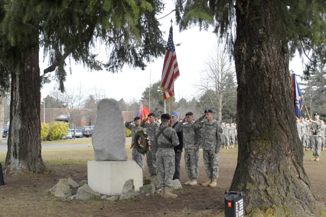 Soldiers from 1-23 Inf., 2-23 Inf., 4-23 Inf. and 1-37 FA salute a memorial to those who died during the 23rd Regimental Combat Team's historic Korean War battle.