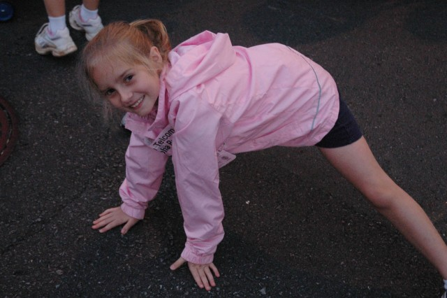HONOLULU - Natalie Pressell, 7, stretches before the big race, the 25th Annual Great Aloha Run. Taking place in both Honolulu and Iraq, the run gave Soldiers and family members a chance to share the aloha of the community race, despite being thousands of miles apart.