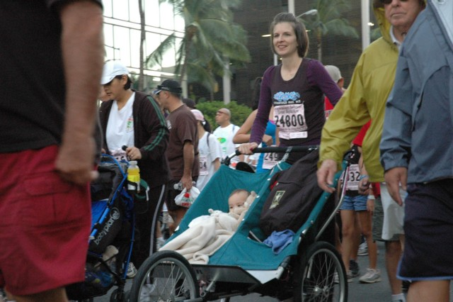 HONOLULU - Danielle Kim pushes 9-month old Madeline in a stroller during the 25th Annual Great Aloha Run. The run, taking place in both Honolulu and Iraq, gave Soldiers and family members a chance to share the aloha of the community race, despite being thousands of miles apart.