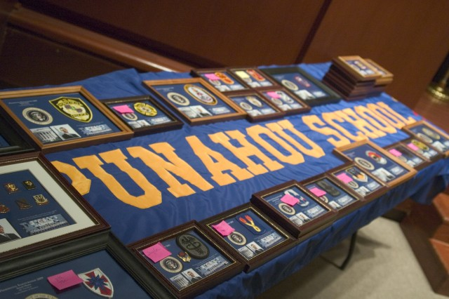 HONOLULU - Unit patches recently carried by Punahou JROTC cadets during the Inauguration parade lined a table at the Wo Auditorium. The patches were framed and returned to each unit during the Punahou School Patch Ceremony
