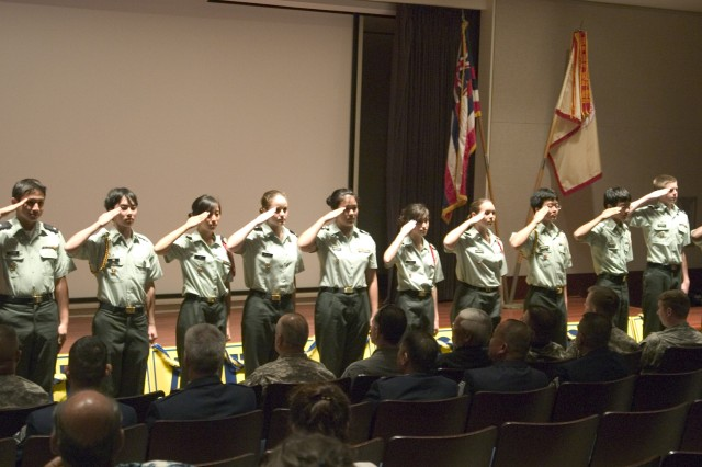 HONOLULU - Punahou JROTC cadets salute the crowd during the Punahou School Patch Ceremony at Wo Auditorium, Feb. 17. Cadets returned unit patches recently carried on their persons during the Inauguration parade in Washington D.C., Jan 20.