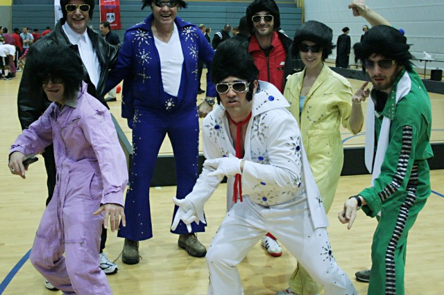 """U.S. Army Garrison Bamberg, Germany, kicked off its new Freedom Through Fitness program Feb. 11 with a Dodgeball Tournament fit for the """"King"""". The garrison morale, welfare an recreation team dressed as Elvis Presley to compete and win the costume contest, but that didn't win them the game. The winners of the dodgeball tournament were """"The Mike Tango"""" team."""