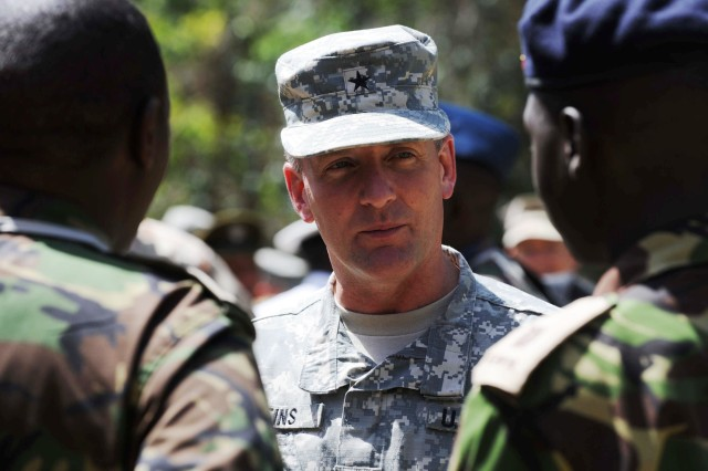 Brig. Gen. Chris Leins, deputy commander of Combined Joint Task Force - Horn of Africa (CJTF-HOA), chats with Kenyan Army officers following their graduation from the Peace Support Operations Course at the International Peace Support Training Centre on Feb. 20, 2009, in Karen, Kenya. Thirty two students from nine East African countries successfully completed the course conducted by CJTF-HOA.