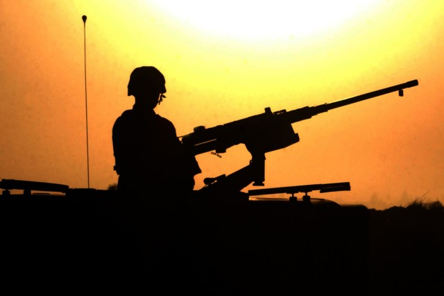 A Soldier provides security with a .50-caliber machine gun at a site near Balad, Iraq, October 14, 2003. The Soldier was assigned to the 4th Infantry Division's Headquarters and Headquarters Company, 1st Battalion, 8th Infantry Regiment. (U.S. Army photo by Sgt. Jack Morse)