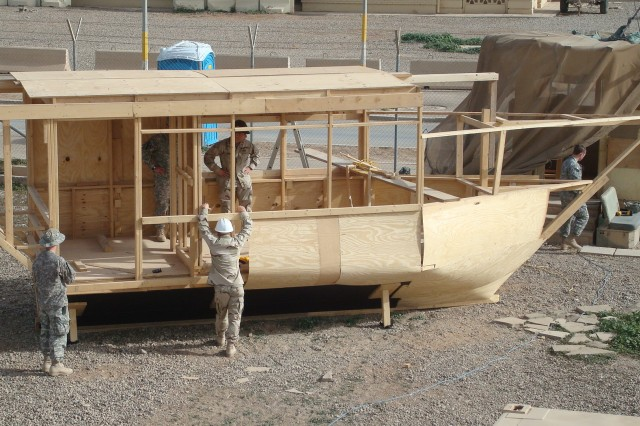 Soldiers and Airmen build ship-like guard shack to bring the sea life to land