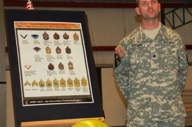 Stripes - Sgt. Brown briefs the history of the NCO ranks and the meaning of the chevron. USAG Schinnen NCOs kicked off the Year of the NCO with an event in the Activity Center Feb 26, which included presentations of NCO history, the NCO Creed and displays.