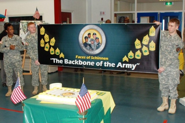 Faces of Schinnen - USAG Schinnen NCOs unveil a banner that will be displayed throughout 2009 - the Year of the NCO. USAG Schinnen NCOs kicked off the Year of the NCO with an event in the Activity Center Feb 26, which included presentations of NCO history, the NCO Creed and displays.