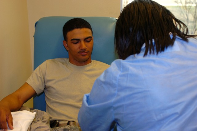 Spc. Kevin Jones, with the 263rd Maintenance Company, Special Troops Battalion, donates blood Feb. 25 at the Robertson Blood Center as a part of the 15th Sustainment Brigade's blood drive. As of Feb. 26, the brigade's Soldiers have donated more than 230 pints of blood.