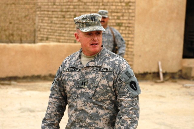 BAGHDAD - Capt. John Robinson, personnel officer for 1st Squadron 124th Cavalry Regiment, 56th Infantry Brigade Combat Team, Multi-National Division-Baghdad, address the crowd attending his promotion ceremony at Victory Base Complex Feb. 27. Robinson, from the small central Texas town of Zephyr, stated that he would not be where he is today without the support of his non-commissioned officers and thanked them for their guidance and patience.
