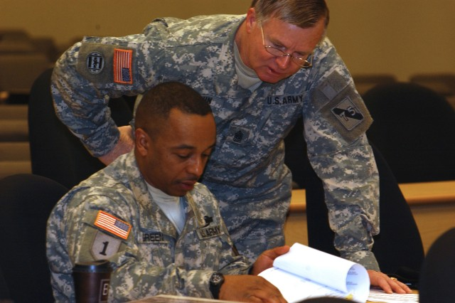 Command Sgt. Maj. Cedric Green, the senior enlisted Soldier for the 479th Chemical Battalion, based at Fort Tilden, N.Y., and Command Sgt. Maj. Thomas Colvin, the senior enlisted Soldier for 4th Battle Command Training Brigade, 75th Battle Command Training Division, review a senior enlisted promotion packet.""