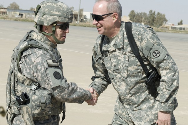 Lt. Gen. Mitchell Stevenson, U.S. Army Deputy Chief of Staff G-4, is greeted by Brig. Gen. Michael J. Lally, 3d Sustainment Command (Expeditionary) commanding general, after arriving at Balad Airfield on Joint Base Balad, Iraq, Feb. 18.  Stevenson visited to assess theater operations including tours of the 3d ESC command headquarters building, 3d ESC public affairs office, 259th Corps Distribution Center, 402nd Army Field Support Brigade, Mine-Resistant Ambush-Protected vehicle yard, Redistribution Property Accountability Team yard, and Convoy Support Center. (U.S. Army photo by Spc. Brian A. Barbour)