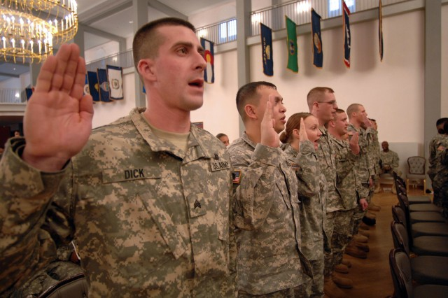 A group of U.S. Army Europe noncommissioned officers pledge their commitment to their duties as NCOs during a NCO induction ceremony at the Patrick Henry Village Pavilion in Heidelberg, Germany, Feb. 27.