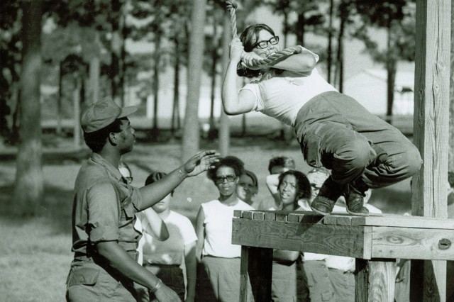 Women's Army Corps members run an obstacle course during basic training with the 1st WAC Basic Training Battalion, Fort Belvoir, Va.