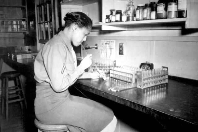 Women's Army Corps Pfc. Johnnie Mae Welton, laboratory technician trainee, conducts an experiment in the serology laboratory of the Fort Jackson Station Hospital, Fort Jackson, S.C., March 20, 1944.