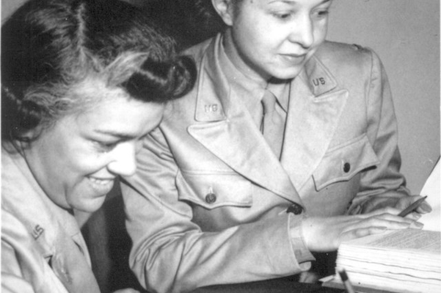 Women's Army Auxiliary Corps members Lts. Harriet West (left) and Irma Cayton, go over their recruiting schedule report at WAAC Headquarters on 26th Street in Washington, D.C., 1942.