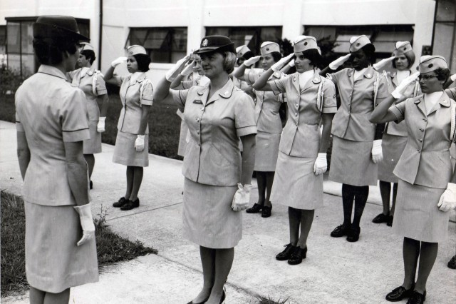 1st Lt. Jacqueline L. Wolfe, unit officer, Headquarters and Headquarters Company, and officer-in-charge, HHC Drill Team, presents the drill team to Maj. Dorothy L. Love, commanding officer, HHC, United States Women's Army Corps Center, June 29, 1967.