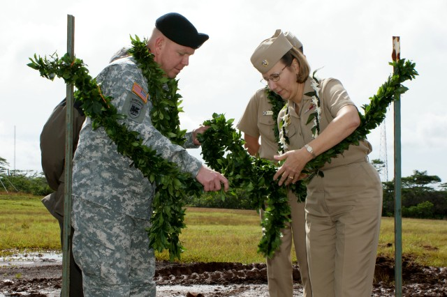 Untieing the maile lei