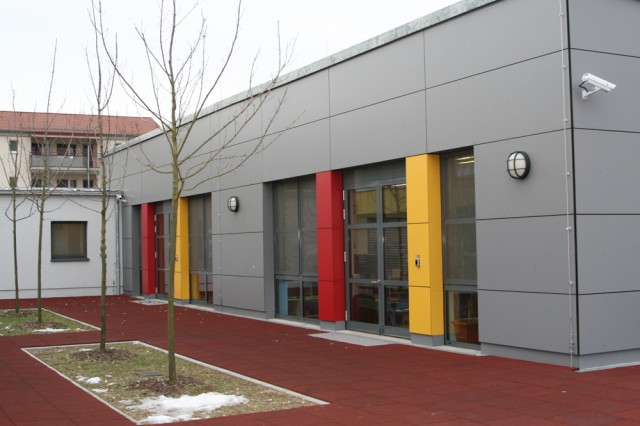 """The newly upgraded Katterbach Child Development Center wing or """"fish bowl"""" as seen from the exterior courtyard view, offers more space to  its primary customers-kindergarteners, preschoolers, and especially infants and toddlers of U.S. Army Garrison Ansbach, Germany. The facility was recently expanded and renovated due to its outdated design to facilitate and offer more service to community families."""