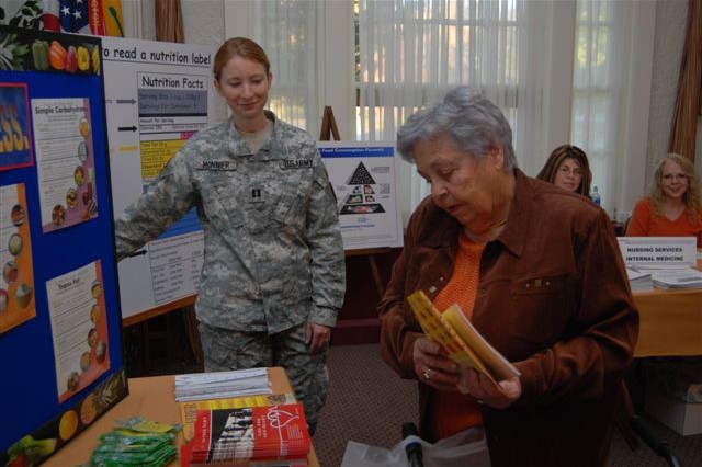Retiree Appreciation Days offer a wealth of information in briefings and handouts. Here a Soldier stands ready to help spouses and retirees with the latest nutrition news at Fort Knox, Ky., Nov. 1.