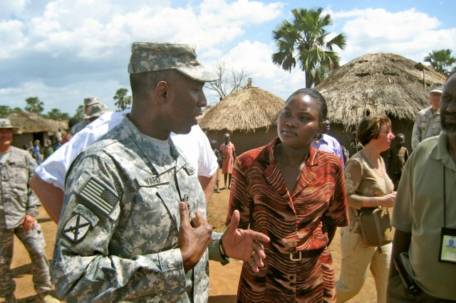 Gen. William Ward, commander, U.S. Africa Command, meets with the northern Uganda program coordinator for Malaria Consortium, April 10, 2008, at the Te-Tugu Camp for internally displaced persons near the town of Gulu in northern Uganda.