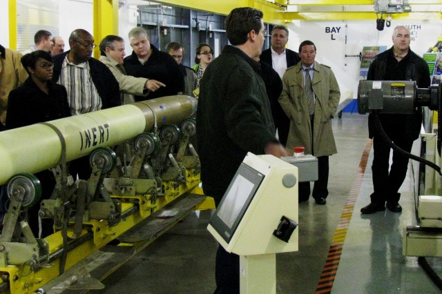 Precision Fires Rocket and Missile Systems Program Management Review attendees receive a tour at Letterkenny Munitions Center.