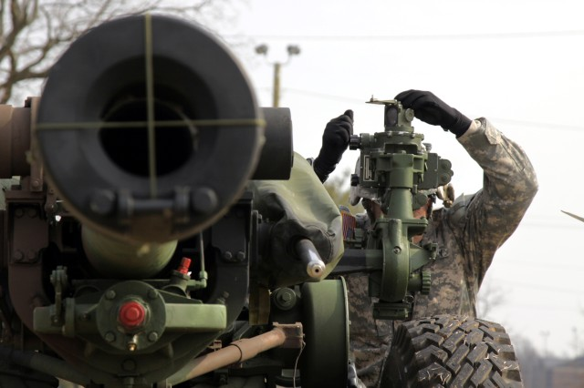 """A """"Balls of the Eagle"""" Soldier from 1st Brigade Combat Team, 101st Airborne Division (AASLT) locates his target with the scope on the M-119A2 Howitzer on Fort Campbell, KY, Feb. 27, 2009.  The Field Artillery Gunners test is a mandatory procedure that must be conducted by Field Artillerymen bi-annually."""