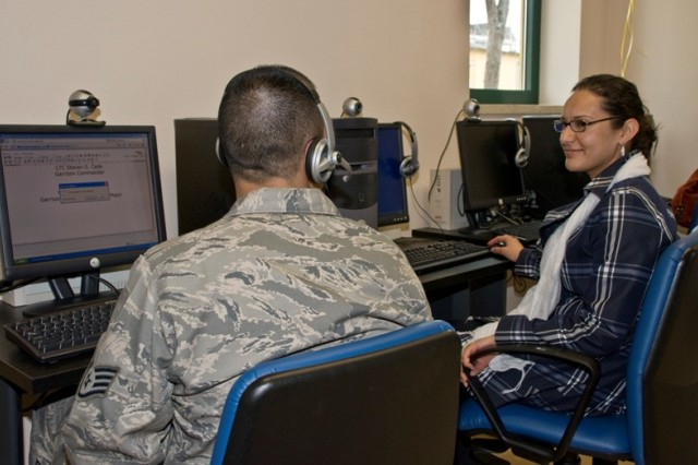 Sgt. Felix Cereceres, 31st Munitions Squadron and his wife Zulma Cereceres try out the latest computer equipment located in the new Camp Darby Service member and Family Readiness Center in Italy. The new equipment will help families keep in touch with their loved ones when deployed.