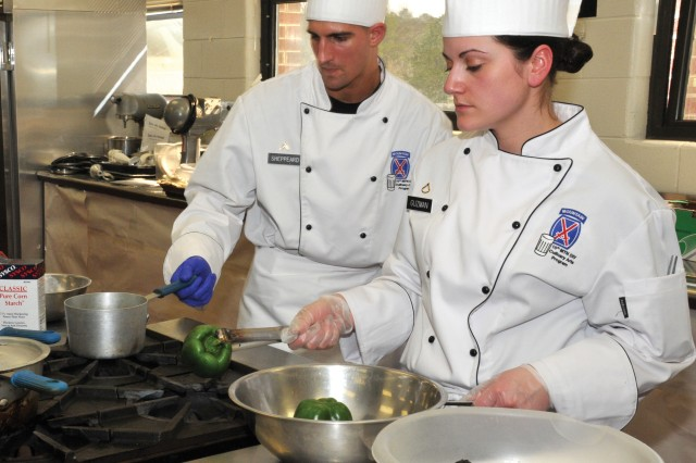 Cpl. Todd Sheppeard and his apprentice Pfc. Lacey Guzman represented Fort Drum in the Armed Forces Chef of the Year Competition March 3 at the 34th U.S. Army Culinary Competition at Fort Lee, Va. Photo by Kimberly Fritz, Fort Lee Public Affairs.