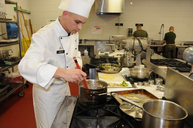 Sgt. Jason Curtis represented Fort Drum in the Practical and Contemporary Hot Food Cooking event March 4 at the 34th U.S. Army Culinary Arts Competition at Fort Lee, Va. Photo by Amy Perry
