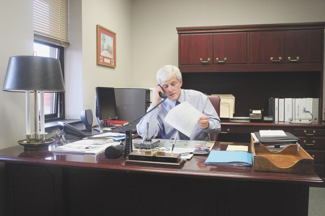 FORT GORDON, Ga.--(March 5, 2009) John Curry, deputy garrison commander juggles the phone and notes during a typical day in his office on post March 2, 2009. Photo by Bonnie Heater