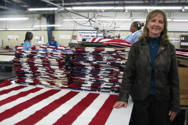 """Janice Caudle, a contracts specialist for Phoenix Manufacturing, helps to keep 82 people with disabilities employed through her work in securing more than $5 million in government and commercial product contracts. The non-profit makes interment flags, parachute harnesses and other products for the U.S. government. Caudle's work was recently recognized with the """"Unsung Hero Award"""" from the South Region of the National Council of Work Centers."""