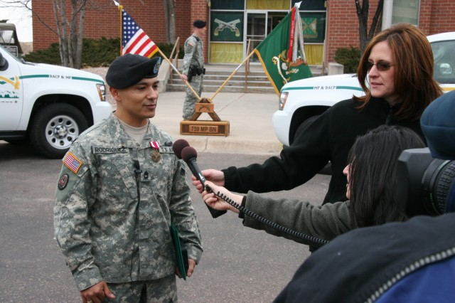 FORT CARSON, Colo.-Sgt. 1st Class Jesus Rodriguez, Headquarters and Headquarters Detachment, 759th Military Police Battalion speaks with members of the local media Feb. 27 regarding his lifesaving efforts involving a fallen climber in the Garden of the Gods.