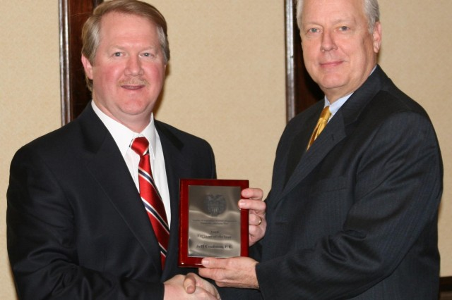 Jeffrey Coulston, left, chief of the Structural Branch, Civil Structures Division, Engineering Directorate, Army Engineering and Support Center, Huntsville, receives the Society of American Military Engineers, Huntsville Post Engineer of the Year award from post president Phillip Loftis.