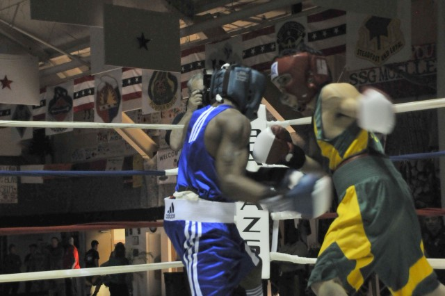 Fort Carson's John Franklin, left, delivers a body blow to United States Olympic Education Center's Rafael Santos Feb. 26, at Fort Carson's Special Events Center.
