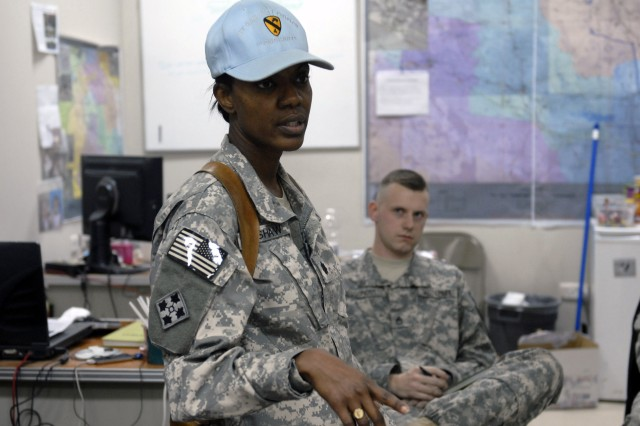 Lt. Col. Monica Bradshaw, the Intelligence Officer for the 4th Brigade Combat Team, 1st Cavalry Division, speaks to her Soldiers at the Brigade headquarters on Contingency Operating Base Adder.  Earlier in the day, she was the guest speaker at the base's Black History Month Observance.