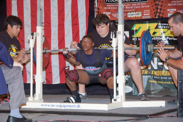 Debra Jackson begins her 259-pound squat, helping her to earn a gold medal.