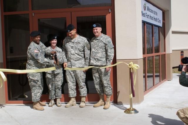 Col. Casper P. Jones III, commander, Carl R. Darnall Army Medical Center; Sgt. 1st Class Barbara Miller , noncommissioned officer in charge, West Fort Hood Health Clinic; Lt. Col. James Geracci, chief of Family and Community Medicine and officer in charge of the WFHHC; and Lt. Gen. Rick Lynch, commander, III Corps and Fort Hood, officially open CDAMC's WFHHC Tuesday, March 4 at a ribbon cutting ceremony. The $9.5 million facility offers full-service health care to West Fort Hood Soldiers and their Families.