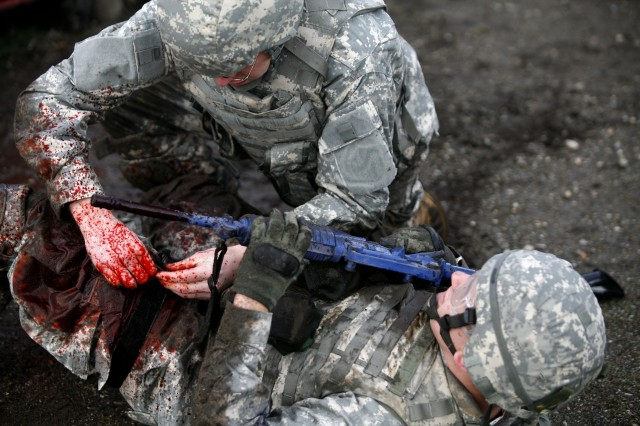 A Soldier treats a simulated casualty, Feb. 25, during an exercise at the Medical Simulation Training Center.
