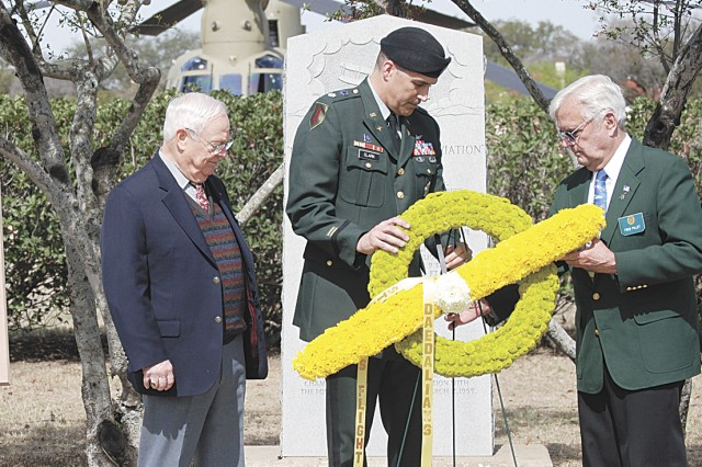 (From left) Keith Ferris, aviation artist, Lt. Col. Daniel Clark, Army North and President, Dibrell/Alamo Chapter, Army Aviation Association of America and retired Air Force Col. Frederick Pillet, acting flight Captain, Stinson Flight No. 2, place a wreath at the Foulois marker commemorating 99 years of the first military flight made by then 1st Lt. Benjamin Foulois.