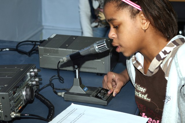 Fifth-grader Katrina Nnadozie attempts to contact someone to chat with on a ham radio Feb. 25 during a demonstration by the Cadet Amateur Radio Club at the West Point Middle School. Cadets from the club helped students try their hand at ham radio and discussed the importance of ham radios during emergencies.