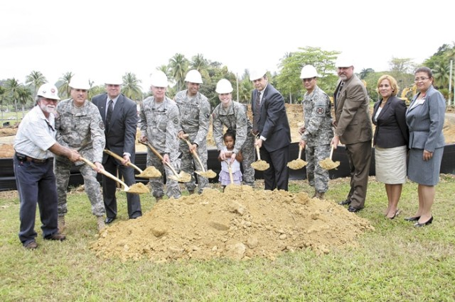 The group performing the ceremonial dedication of the site was (left to right) Leonel Torres, Department of Public Works, Engineering Division; Fort Buchanan Sergeant Major David Davis; DFMWR Director Dallas Petersen; Maj. Gen. Charles E. Gorton, commanding general, 81st Regional Support Command; Master Sgts. Richard and Brooke Montgomery and daughter Ariela; Davis D. Tindoll, regional director, IMCOM-SE; Fort Buchanan Commanding Officer Col. Edwin C. Domingo; Deputy to the Garrison Commander Gunnar Pedersen; Child Development Center Manager Carmen Dieppa and Maria Martinez.