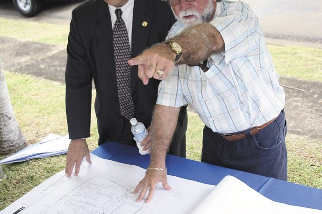 Davis D. Tindoll, regional director, Installation Management Command Southeast receives a briefing on the CDC project from Leonel Torres, Engineering Division, Fort Buchanan Department of Public Works.