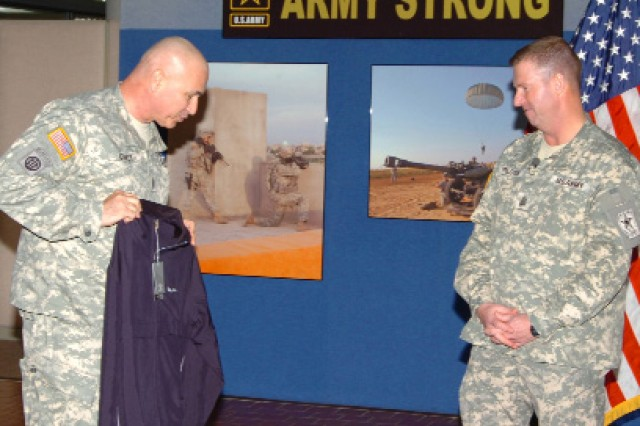 Command Sgt. Maj. Dennis M. Carey, FORSCOM command sergeant major, presents Preston with a FORSCOM golf jacket in appreciation for Preston's visit.   Preston talked to the Soldiers about the Year of the NCO Army theme for 2009 and other military issues.  Preston's noon speech to the FORSCOM Soldiers included a question-and-answer session.