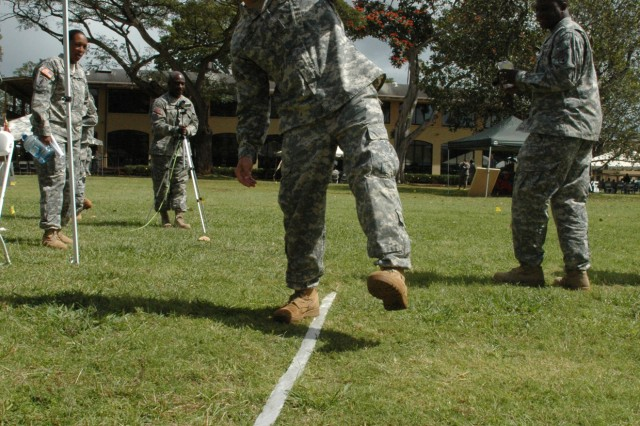 """SCHOFIELD BARRACKS, Hawaii - Sgt. James Dortmundt, TAMC, fails to walk a straight line while wearing """"drunk goggles"""" during an experiment administered at the Schofield Barracks Health Clinic safety standdown, Feb. 28. The day consisted of numerous briefings regarding the use of drugs and alcohol."""