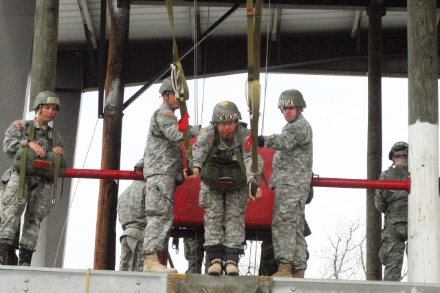 MSG Gary Qualls prepares to jump from a 12-foot platform using the Swing Landing Trainer Feb. 25 on Eubanks Field.