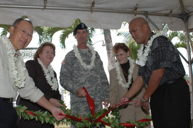 SCHOFIELD BARRACKS, Hawaii - From left: Roy Hung, vice president of retail, Goodwill Contract Services, Hawaii; Laura Robertson, Residential Communities Initiative Project Manager, U.S. Army Garrison-Hawaii (USAG-HI); Col. Matthew Margotta, commander, USAG-HI; Ann O'Leary, president/CEO, Goodwill Contract Services; Hawaii; and Peter Batalon, Army Soldier Housing director, Goodwill Contract Services, Hawaii; untie the maile during the First Sergeants Barracks Initiative opening ceremony, Feb. 27.