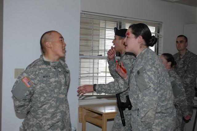 CUTLINE: Pvt. Garrett Miyata and Pvt. Cassandra Prange, both Company E, 795th Military Police Battalion, do a role-playing exercise in domestic disturbance training, Feb. 27.