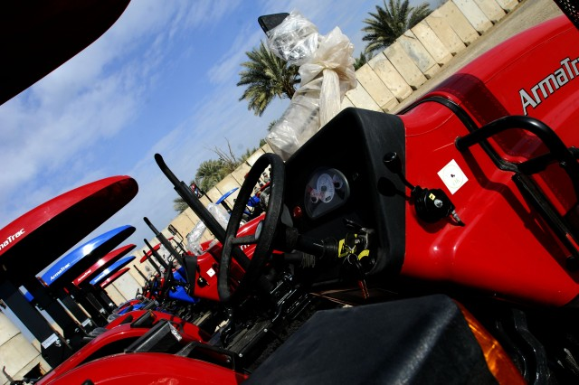 BAGHDAD- A line of ArmaTrac 602 tractors presented to local Sheiks in the Lutifiyah Nahia by Task Force 4th Battalion, 27th Field Artillery during a ceremony held at Combat Outpost Meade March 5.